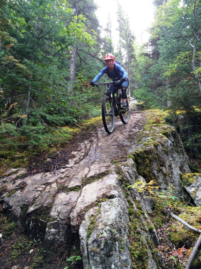 Navigating the end of the rock slabs on 'Grizzly' in Carcross, Yukon.